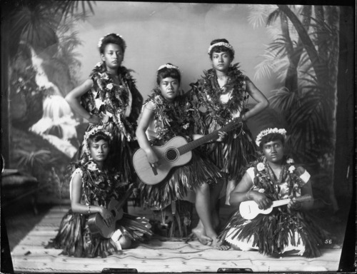 Five hula dancers with ukulele and guitar. ca. 1890's [***]
