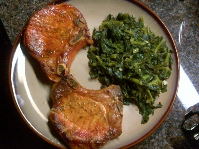 Spanish Style Pan-Seared Pork Chops with Sautéed Garlic Kale Need: Frying Pans/Skillets Overnight prep Ingredients: EVOO Kale, 1 bunch 2 Pork chops, bone-in For Marinade: 1 tbsp. freshly chopped rosemary ¼ cup Lime Juice, freshly squeezed 2 cloves garlic, minced For Spanish style seasoning: Garlic Powder Onion Powder Salt Parsley Oregano Cumin Black Pepper Tumeric For the Sautéed Garlic Kale: ½ cup chicken stock (veggie stock could be used as well) 4 cloves garlic, minced 2-3 tbsp. EVOO S&P, to taste Make:Overnight Prep: Using the above marinade, let the pork chops bath, fully covered in a deep dish, overnight in refrigerator. Wash kale, shake to dry. Remove center stem and tear leaves into several smaller pieces. Store in bowl in refrigerator. Seasoning: Depending on quantity of pork chops, create about a cup of the following ingredients, using equal proportions of each spice: Garlic powder, Onion Powder, Salt, Oregano, Parsley, Cumin, Tumeric and Black Pepper. Pat the pork chops dry and sprinkle with the Spanish style seasoning. Heat up the skillet, over medium heat, and add EVOO. Wait until its extremely hot and then add the pork chops. Sear each side for about 3 minutes or until browned then flip and repeat on other side. Remove from heat and let sit for a few minutes until Kale is ready. Over medium heat, add EVOO and garlic. Sauté until soft, but not browned. Add kale and chicken stock and cover. Sauté for about 5 minutes. Kale should be wilted, but still bright green. For the last minute, toss kale around and sprinkle with S&P. Immediately plate next to the chops and serve! Enjoy!! FOR MORE GREAT RECIPES, CHECK OUT OUR WEEKLY COLUMN IN PALEO LIFESTYLE MAGAZINE ONLINE.