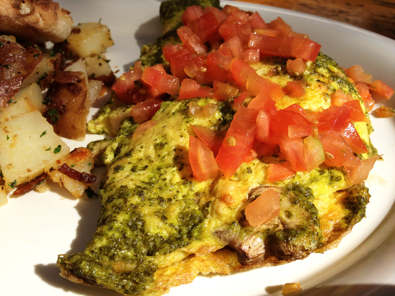 Greek omelet with feta, spinach, and tomatoes. Opa! -Braised Bombshell