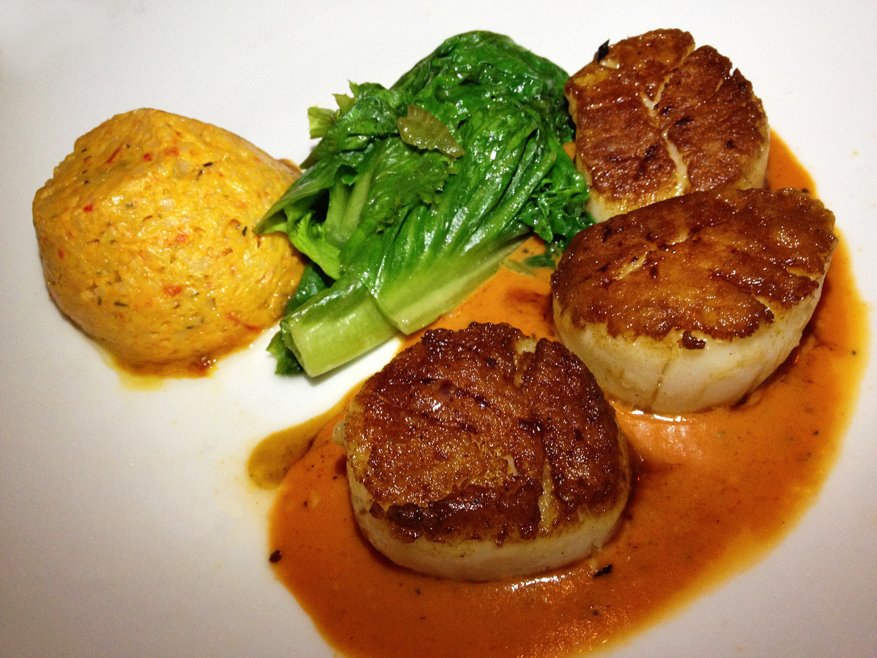 Scallops cooked to absolute perfection in a tomato truffle butter dressing with a side of bok choy and some kind of yummy savory rice pudding from Passion Fish. -Gastrodamus