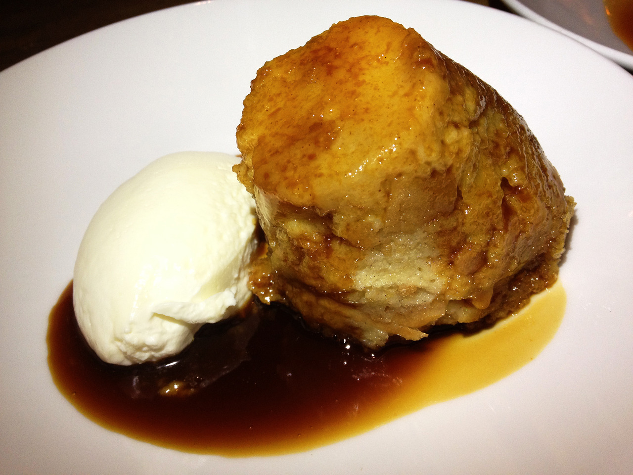"AHHHHHHHHHHHHHHHHH bread pudding! It's my kryptonite, I can't NOT order it whenever I see it on a menu. Sure giving in and eating the entire thing will make my zipper embed itself into my lower tummy creating a Frankenstein-like scar when I take them off later that night, but I'll gaze at my protruding belly and smile when I remember the caramel greatness. Maybe I'll even grab and jiggle it a la Honey Boo Boo and say some sassy one liner like ""Everybody a little bit fat-ass."" The gang (Gastrodamus, Black Angus and #ogccpg) finished off dinner at Passion Fish with two desserts, I'm proud to show that the bread pudding was one of them. And may I add, one of the best I've had. I loved how they flame torched the shit out of the top creating a creme brulee style sugar crackling that made me wish chicharrones came in caramel-bread instead of pork. -Braised Bombshell"