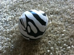 #less365, day 302: one less zebra-striped hacky sack ball thing that I won in a carnival game. Regifting to a friend's almost-teenage daughter.