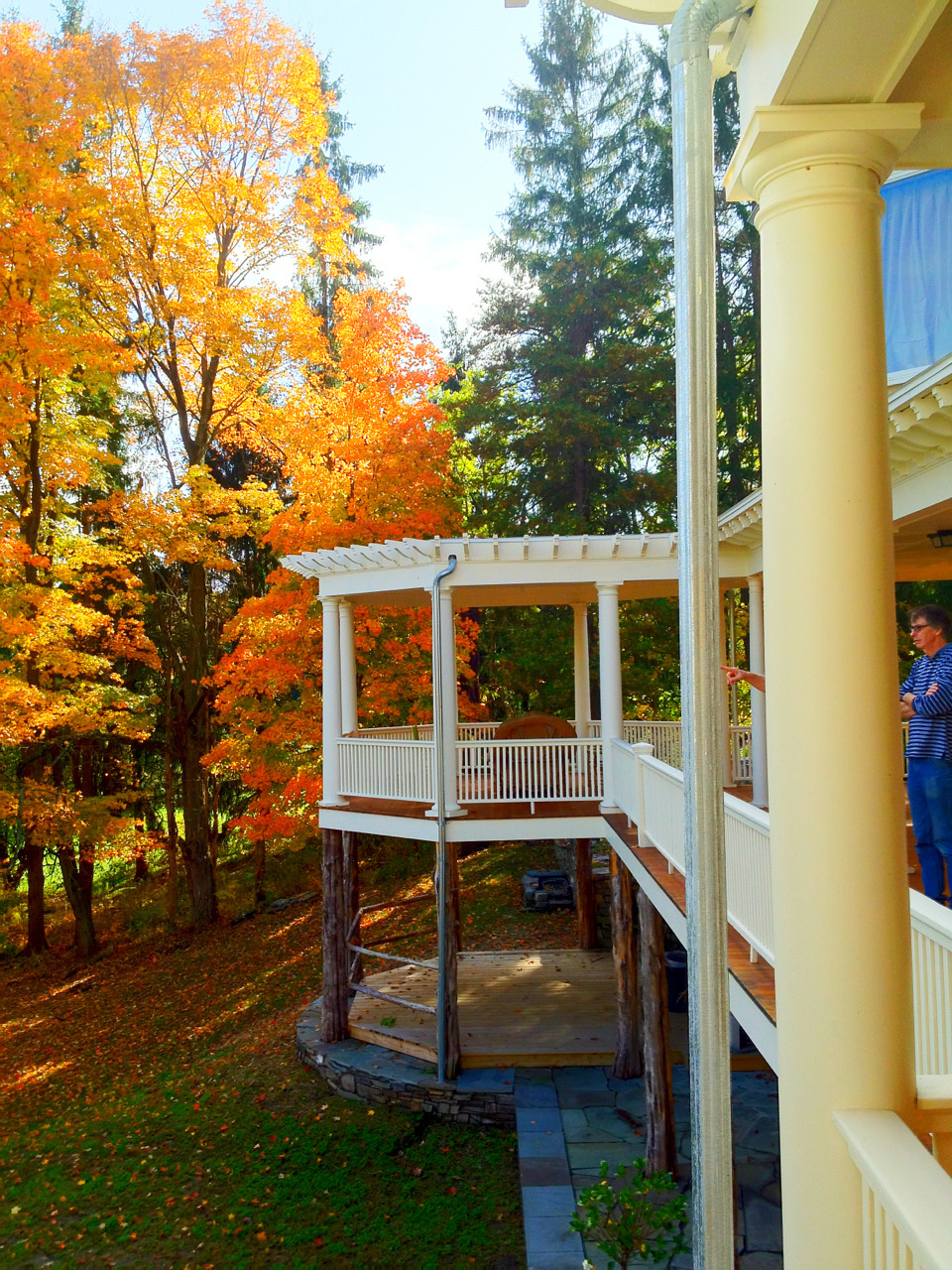 The restored wrap around porch at HeartsEase mansion overlooks the Hudson River