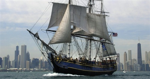 breakingnews:  Rescue under way on tall ship stricken by Hurricane Sandy, 14 of 17 safe WITN: Officials say a ship with 17 people onboard is sinking off our coast, which forced the crew to abandon ship into 18-foot waves and 40 mile per hour winds off the North Carolina coast. The Coast Guard is working to rescue the crew of the HMS Bounty, a 180-foot, three-mast tall ship which was last marked about 90 miles southeast of Hatteras. You can follow all our Hurricane Sandy updates on BreakingNews.com here: http://bit.ly/TbgQ7S Photo: The HMS Bounty, a replica used in the Marlon Brando movie 'Munity on the Bounty' pictured sailing past the Chicago skyline in July 2003 (Jeff Haynes / AFP - Getty Images, file)