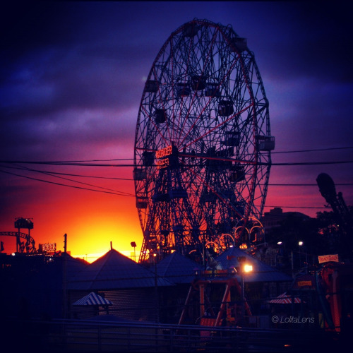 """The Sun Sets on Coney Island""  Yesterday was the final day of the season for Coney Island's amusement parks. Full of character, quirkiness, fun and games, Coney is (and has always been) my favorite place to shoot.   Brooklyn, NY"