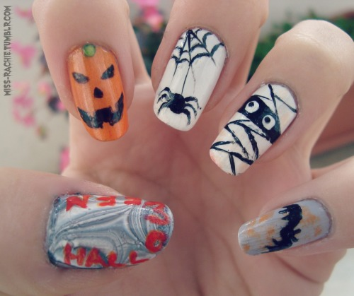 Halloween nails :DColors used: Nail Paint by BarryM: Matt White Nail Paint by BarryM: Black Catrice: Sing hey, Dirty-Lilah! Eveline: Color show (498) Maybelline mini Colorama: Urban orange