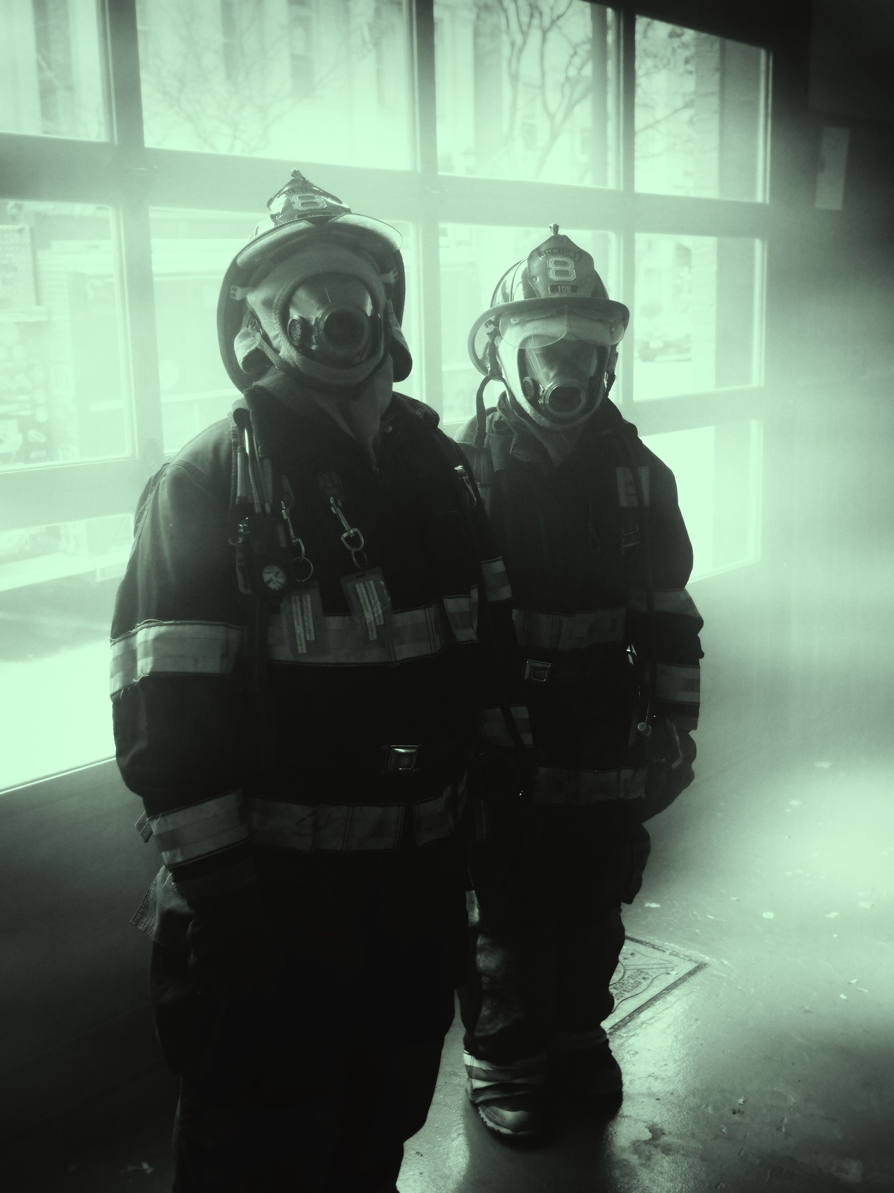 Firefighters : Hudson, New York These are young teenagers helping prepare for Hurricane Sandy. They were training with fog machines inside the station the day before landfall.