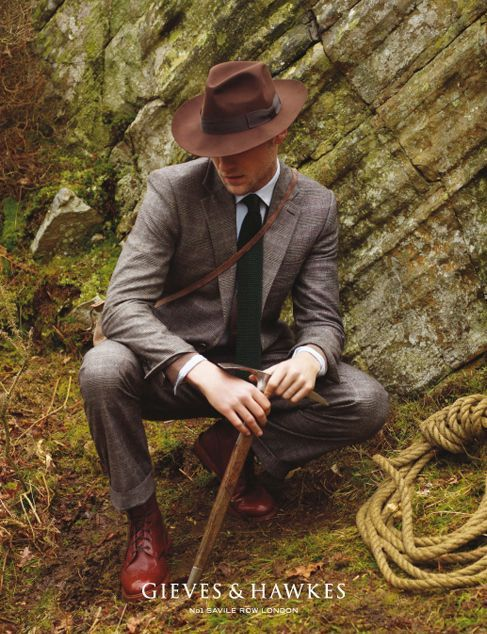 iqfashion:  Gieves & Hawkes  Wait, you mean svelt men in Indiana Jones hats and James Bond suits don't usually meander the woods (in their off time from saving the world) to woo the hand of a quippy camp counselor.  I should probably go back and tell 15-year-old me that.  But it's nice to know my tastes haven't changed.