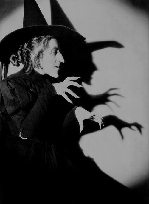 "nexiv:  The ""Wicked Witch of the West"" (played by Margaret Hamilton) from the 1939 film version of ""The Wizard of Oz"" has become a standard for what witches look like and an archetype for human wickedness. Here she is represented as a stooped, green-skinned witch dressed in a long black dress with a black pointed hat. Studio executives cut some of Margaret's most wicked scenes, worrying they would frighten children. Photo taken at MGM Studios Culver City, California, USA on 1939"