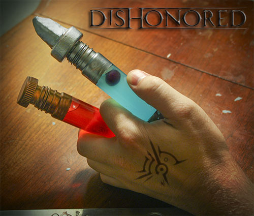 "thedrunkenmoogle:  Dishonored Elixer and Remedy Shots Sokolov's Very Cherry ElixirIngredients:1 part Cherry Soda1 part Cherry Moonshine (Junior Johnson's Midnight Moon used)1 Maraschino cherry Directions: Combine the soda and moonshine, then top with cherry. Best served chilled. Useful for staving off the rat plague while avenging the murder of your empress. ""Promotes robust health and fitness!"" ___  Piero's Spiritual Blueberry RemedyIngredients:1 part Jones Blueberry Lemonade soda1 part HpnotiqA couple of Moonshine blue berries  Directions: Mix liquid ingredients and top with berries. Best served chilled. For those who bear the mark of the outsider. ""Guaranteed to lift your spirits!""  Drinks created and photographed by Deena and Kyle."