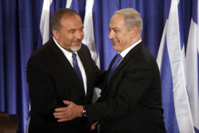 newyorker:   …Netanyahu announced that he and his Likud Party had formed an alliance with the Foreign Minister, Avigdor Lieberman, and his Russian-dominated Yisrael Beiteinu Party (the Our Home Israel Party) for elections on January 22nd. In the 2009 elections, Netanyahu ran to the center-left (at least by the standards of an ever more conservative political map), but now he has thrown in with the country's most prominent xenophobe. Lieberman, who emigrated in 1978, lives in the West Bank settlement of Nokdim. He admires Vladimir Putin. He is so given to outrageous statements about Arabs that foreign reporters are rarely allowed to talk to him. Political insiders in Israel know that Netanyahu and Lieberman distrust each other, but their newfound alliance makes it almost impossible for a center-left bloc to win in January. Their leaders are, to the last, extremely weak….  David Remnick on Israeli Prime Minister Benjamin Netanyahu's dark choice on Iran:    http://nyr.kr/S86Xt6     Photograph: AFP/Getty.