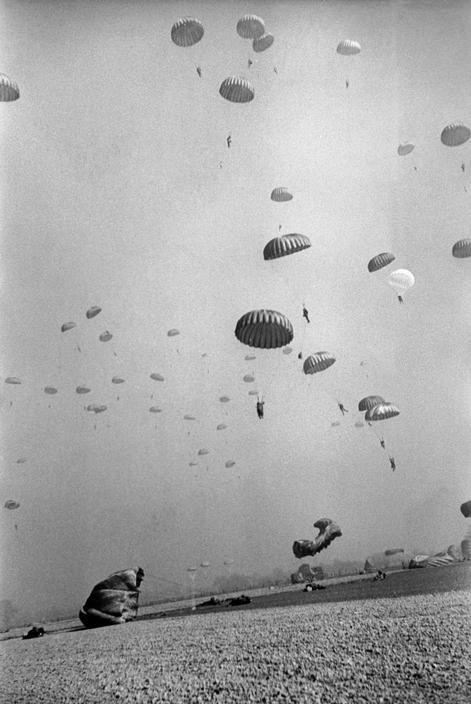 collective-history:  American paratroopers landing in Germany, 1945, by Robert Capa.