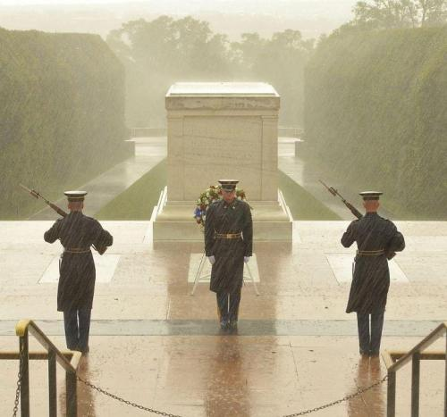 """Soldiers of the Third Infantry Regiment continue to stand guard at the Tomb of the Unknown Soldier Monday morning, despite the worsening weather conditions surrounding Hurricane Sandy. The tomb has been guarded continuously since 1948."" (US Army photo) UPDATE: This photo is from last September, and it appears even some Army social media folks have been pwned. But the Third Regiment (""the Old Guard"") hastens to add that its soldiers *are* on post today, and here are the pics to prove it."