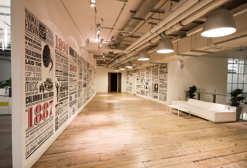 "Sony Music Timeline by Alex Fowkes ""The Sony Music Timeline celebrates 125 years of musical history covering almost 150 square meters of wall space in Sony's Derry Street offices. Using just CNC cut vinyl as the sole medium, 54 columns measuring over 2 meters tall cover feature nearly 1000 of Sony Music's signed artists from 1887 to the present day."" Videos to demonstrate the work are embedded below.  Artists: 