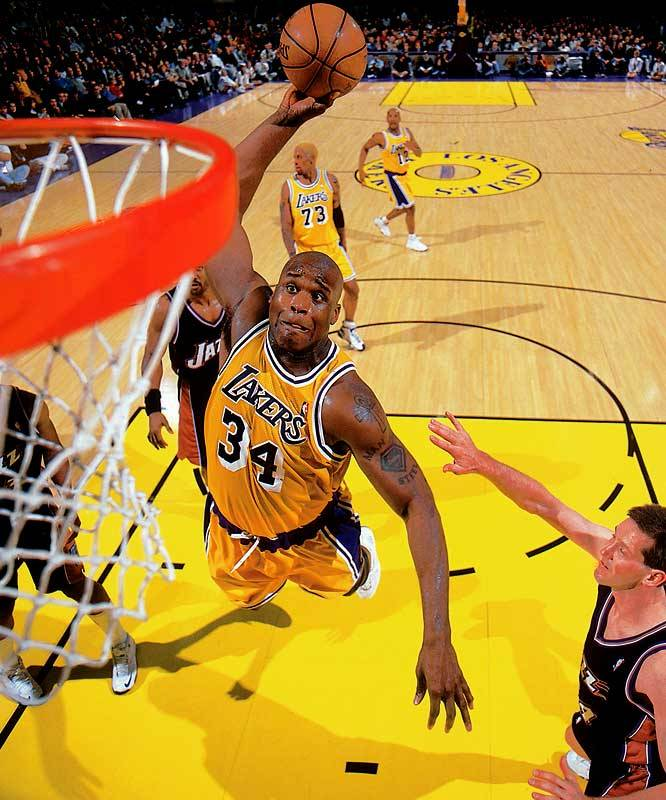 Lakers center Shaquille O'Neal throws down a monsterous dunk during a 2000 game against the Jazz. (John W. McDonough/SI) GALLERY: Classic Photos of Shaquille O'Neal