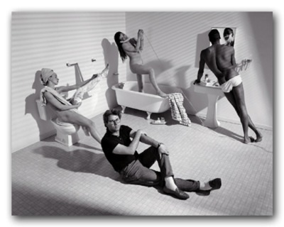 "Louie Psihoyos, staged portrait of Eric Fischl with models in studio   I took a series of photgraphs of artists done in the style of their own work. There has been much said of the psychological loading of Fischl's work so I built a bathroom at about a 30% angle in my studio to may the viewer feel even more off balance for my portrait of the painter. Eric wasn't used to working with nude models for his work. He usually grabbed snapshots of nudes from his trips to places like St. Tropez and painted them into his scenes once back at his New York studio. He'd painted hundreds of nudes by then but was fairly shocked at the idea of women and men taking their clothes off while you worked. ""You mean you just pay them and they take their clothes off?"" he asked. ""I'd never get any work done if I had naked people running around my studio."""