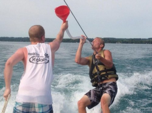 Guy Beer Bongs While Water Skiing Dude, you can't spell teamwork without those words. I don't know I'm so drunk right now.