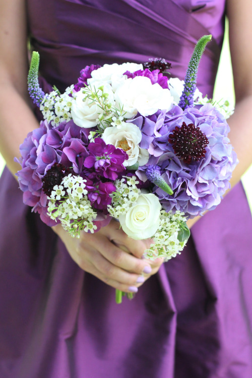 Rich purples are stunning at this outdoor wedding. By Event Designs by Katherine.