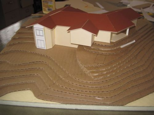 A working model by my father's firm, Greenberg Associate Architects.  The contour lines reveal a non-trivial projection from the represented 3D space to the 3D representation itself.