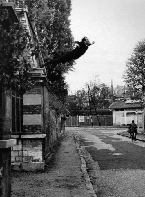 "museumuesum:  Yves Klein Leap into the Void (photographed by Harry Shunk), 1960 gelatin silver print, 25.9 x 20 cm (10 3/16 x 7 7/8 in.) As in his carefully choreographed paintings in which he used nude female models dipped in blue paint as paintbrushes, Klein's photomontage paradoxically creates the impression of freedom and abandon through a highly contrived process. In October 1960, Klein hired the photographers Harry Shunk and Jean Kender to make a series of pictures re-creating a jump from a second-floor window that the artist claimed to have executed earlier in the year. This second leap was made from a rooftop in the Paris suburb of Fontenay-aux-Roses. On the street below, a group of the artist's friends from held a tarpaulin to catch him as he fell. Two negatives—one showing Klein leaping, the other the surrounding scene (without the tarp)—were then printed together to create a seamless ""documentary"" photograph. To complete the illusion that he was capable of flight, Klein distributed a fake broadsheet at Parisian newsstands commemorating the event. It was in this mass-produced form that the artist's seminal gesture was communicated to the public and also notably to the Vienna Actionists."
