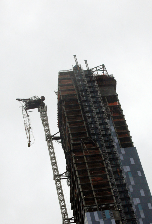 soupsoup:  A partially collapsed crane hangs from a high-rise building in Manhattan as Hurricane Sandy makes its approach in New York October 29, 2012. REUTERS/Brendan McDermidFollow live updates on Hurricane Sandy   Wowza.