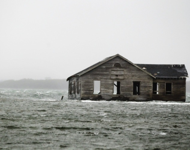 An abandoned home stands its ground among the flooding water in Southampton, NY on Oct. 29, 2012.