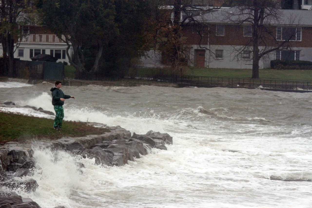 Andy Landy, 13, of New Rochelle watches the waves caused by Hurricane Sandy at Davenport Park in New Rochelle on Oct. 29, 2012. ( Carucha L. Meuse / The Journal News )  Find updates throughout the evening and night on LoHud.com.