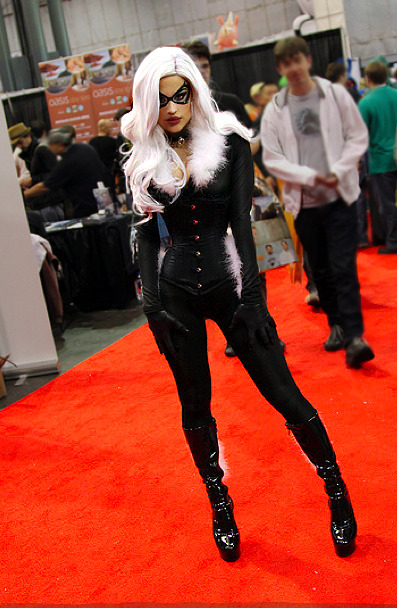 beautilation:  Black Cat cosplay at this year's Comic Con. I worked pretty hard on the entire costume but I think the toughest part was wearing that 18 inch corset all day. No, the hardest part was not being able to eat more than a bite of a big pretzel all day because digesting does not happen in an 18 inch corset.