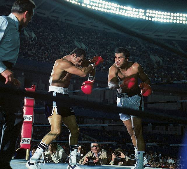 Muhammad Ali punches Ken Norton during their 1976 fight at Yankee Stadium. The two fought twice in 1973, splitting the fights, before the '76 rubber match. Ali slugged his way to a unanimous decision in 15 rounds. Norton's own coaches believed their fighter had a comfortable lead heading into the 15th and advised Norton to stay away from Ali, which he did, possibly giving the fight away. After the bout, even Ali admitted he thought he had been beaten. (Jerry Cooke/SI) GALLERY: The Best of Muhammad Ali