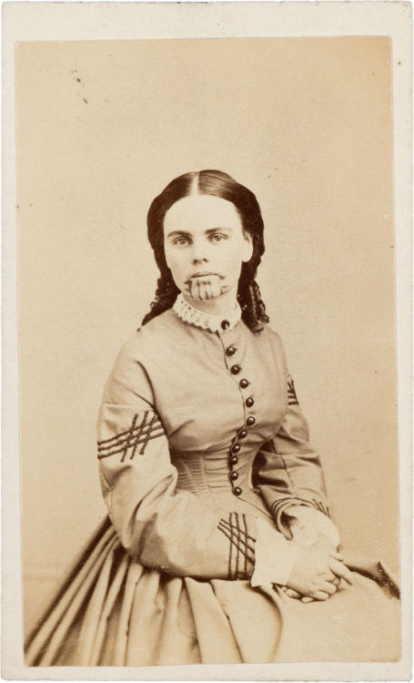 "ca. 1860-70's, [carte de visite portrait of Olive Oatman, Survivor of the Oatman Massacre and held five years in captivity by Yavapais indians]  ""In 1851 Olive Oatman survived the brutal massacre of most of her family by the Yavapais in Arizona and was held in captivity for five years. While in captivity she was tattooed on her face and arms in the tribal tradition.""  via Heritage Auctions"