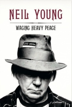 lareviewofbooks:    The truest observation one can make about Neil Young's new memoir Waging Heavy Peace: A Hippie Dream is that it is a book by Neil Young. It is ornery and messy and irrepressibly enthusiastic, the book one might write if he was also the kind of person prone to, say, spending three million dollars to rent a Hollywood soundstage in order to make a bizarre comedy about nuclear destruction co-starring Dennis Hopper and Devo. Or develop a mid-life obsession with model trains and end up buying a major share of Lionel. They are the same whims that have also borne the 66-year-old Young through a five-decade career, careening between mournful folk and silvery feedback sessions, and define the central mystery of his music. Using his 37 proper albums and endless bootlegs to try to reverse-engineer the person behind them, one might end with a somewhat reasonable idea of just who Neil Young is. But even that probably can't adequately prepare a reader for the experience of spending nearly 500 pages inside Young's head. For reasons having little to do with sex or drugs, Waging Heavy Peace might be the most authentically demystifying rock memoir yet ever penned.  Read Jesse Jarnow's review of Neil Young's new memoir.   gotta check this out. Love my NYoung tunage