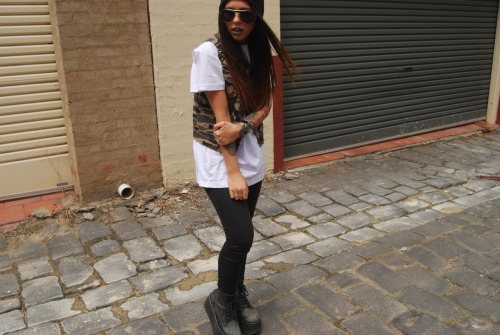 alyssmnhawthorn:  Plain white tee, Camo Vest, Black metallic coated jeans & beanie all from ALYSSMN.Sunglasses: ChloeShoes: Jeffrey CampbellWatch: Marc Jacobs