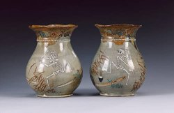catafalques:  A macabre pair of stoneware vases: A macabre pair of stoneware vases, each one decorated with dancing skeletons; one skeleton plucking the samisen presumably in a ghostly parody of the kouta or nagauta; both 8.5 inches [21 cm] high, Meiji Period or later