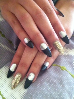 Silver and matte black with gold accent nails!