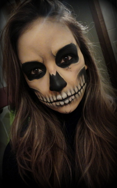 Awesome skull face makeup by Raquel F.!