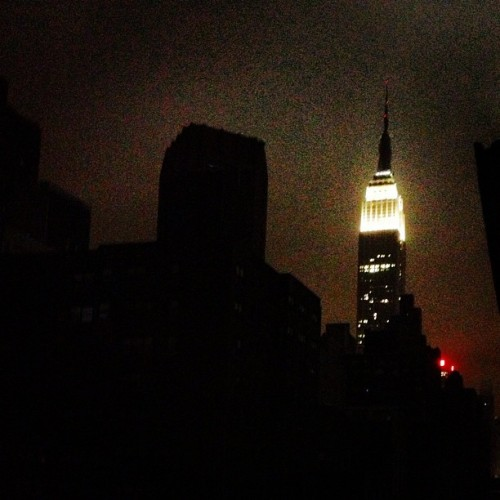 josiahdleming:  NYC just lost power. The empire stands alone.  It feels too eerie.