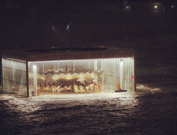 buzzfeed:  Jane's Carousel in Brooklyn, which is now in the East River.  Eeerie #floatingcarousel. Stay safe & positive victims of #Sandy