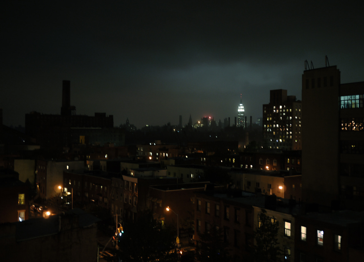 blacked out manhattan skyline.  makes the empire state building seem so much brighter.