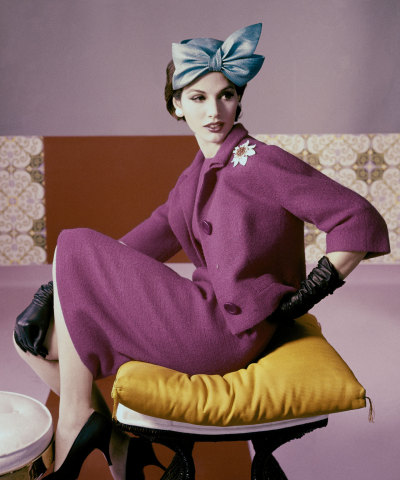 vogueaustralia:  A model wears a fuscia dress suit and hat with bow detail by Emme, 1961. #Vogue 365