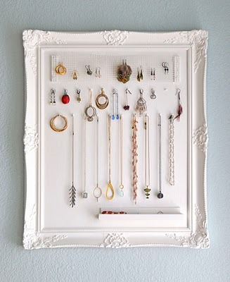 scissorsandthread:  Jewelry Frame | Monaluna I know, I know, there are a million picture frame jewelry storage DIYs out there… but just because you've seen one doesn't mean you've seen them all! The lace ones are good for earrings but only hooks - the studs with backings are more trouble than they're worth to get on and off. But then the frames with hooks have nowhere to put earrings! Well here is a combination of the goodness from both - hooks for necklaces and a little tray for your earrings. Everything together in one place, plus it looks cute to boot!