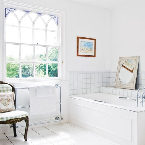 bright bathroom with a lovely window and little frame
