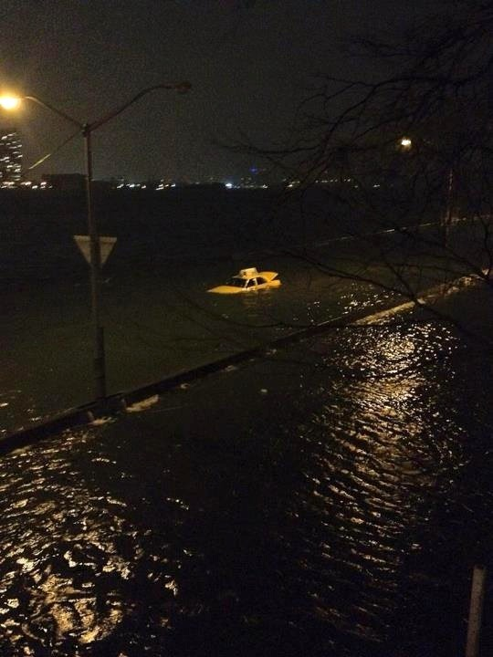 Yellow Submarine? Left Alone… a taxi sits submerged by flood waters in NYC. Photo from @binkholderfield | via MR TWISTER/Facebook> | post by ysvoice