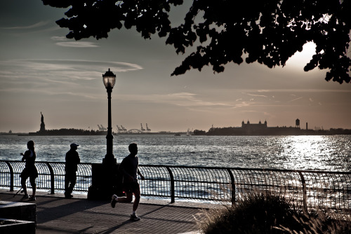 Liberty & Ellis islands from The Esplanade - Battery Park. New York City.