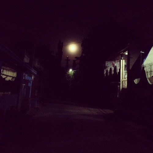 I was walking down our dark, creepy street (which I absolutely love walking through when I go home at night). The moon was at it's fullest, no stars, just the big round ball in the sky. I felt the need to take a pic but I only got my stupid iPhone with me so this was the best shot I could make with my iPhone camera. (at Home)