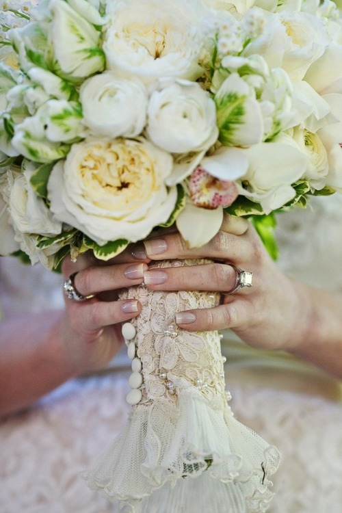Something old: The sleeve of your mother's wedding dress around your bouquet
