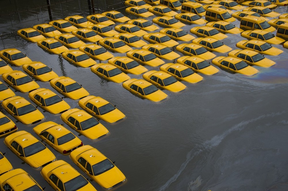 buzzfeedandrew:  A parking lot full of yellow cabs is flooded as a result of Hurricane Sandy in Hoboken. (AP)   Dang