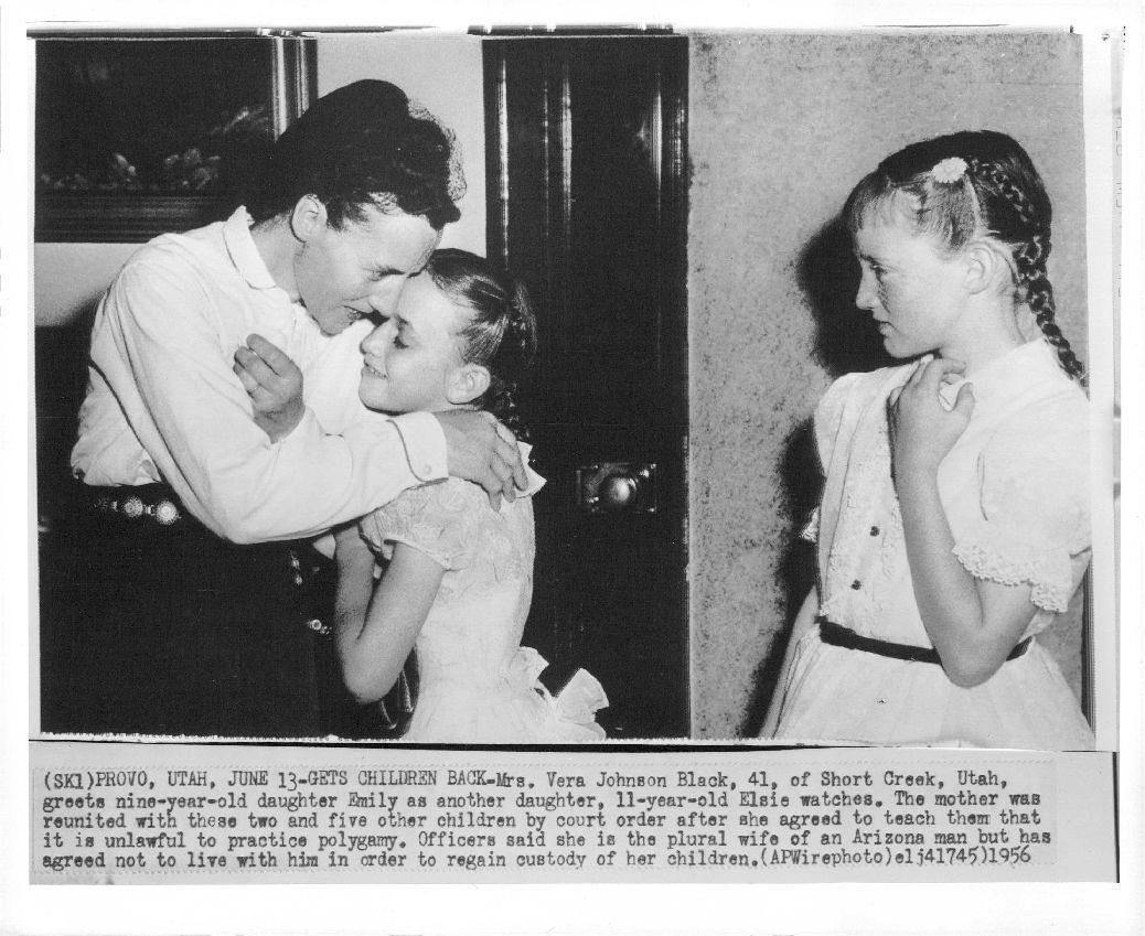 caption text -  JUN 13 1956, GETS CHILDREN BACK — Mrs. Vera Johnson Black, 41, of Short Creek, Utah, greets nine-year-old daughter Emily as another daughter, 11-year-old Elsie watches. The mother was reunited with these two and five other children by court order after she agreed to teach them that it is unlawful to practice polygamy. Officers said she is the plural wife of an Arizona man but. has agreed not to live with him in order to regain custody of her children. 1956 Credit: AP Wirephoto  via ebay read more about Vera Black and her children