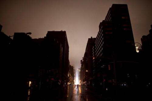 "Little man in the big, dark city: ""Power outage seen on October 29, 2012 in Manhattan, New York. Hurricane Sandy, which threatens 50 million people in the Mid-Atlantic area of the United States, is expected to bring days of rain, high winds and possibly heavy snow. New York Governor Andrew Cuomo announced the closure of all New York City bus, subway and commuter rail services as of Sunday evening."" (Photo by Allison Joyce/Getty Images; ht @AdamGriffiths)"