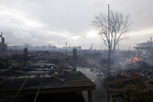 Damage caused by a fire at Breezy Point is shown in the New York City borough of Queens, on October 30, 2012. The fire destroyed between 80 and 100 houses Monday night in the flooded neighborhood. More than 190 firefighters have contained the six-alarm blaze fire, but they are still fighting some pockets of fire. Photo: Frank Franklin II/Associated Press