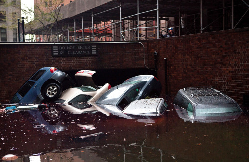 Cars floating in a flooded parking garage entrance, on October 30, 2012 in the Financial District of New York. Photo: Andrew Burton/Getty Images